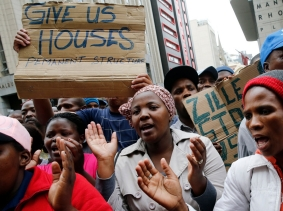 Protestors demonstrate against a lack of housing outside provincial government buildings in central Cape Town, October 30, 2013