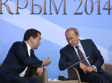 Russia's Prime Minister Medvedev and President Putin attend a meeting with members of the Russian Parliament in Yalta, Crimea, August 14, 2014