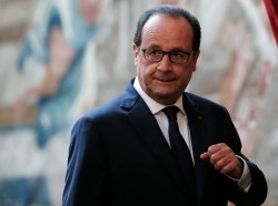 French President Francois Hollande arrives at the Elysee Palace in Paris to speak about French airstrikes in Iraq against Islamic State militants, September 19, 2014