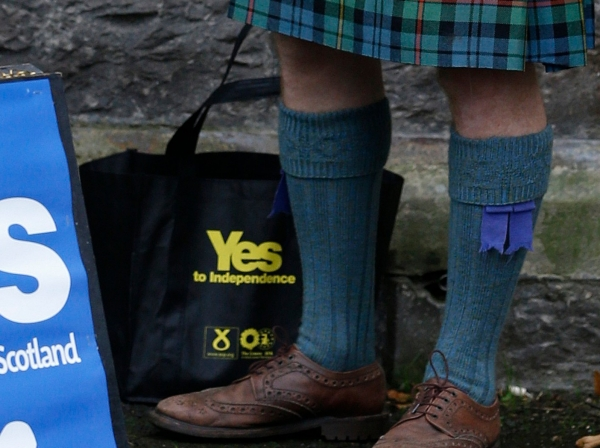 A supporter of the 'Yes' campaign stands outside a polling station during the referendum on Scottish independence in Pitlochry, Scotland, September 18, 2014
