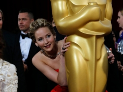 Oscar-winning actress Jennifer Lawrence has contacted authorities to investigate who stole and posted nude images of her online, part of a reported mass hacking of celebrities' intimate photos