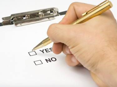 Yes and no boxes on a clipboard