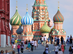 People walking near the Red Square and St. Basil's Cathedral in Moscow, Russia