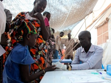 A girl is tested for malaria at an MSF clinic in Tomping camp, where some 17,000 displaced people who fled their homes are being sheltered by the United Nations, in Juba, South Sudan