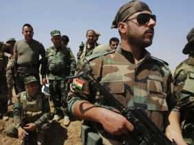 Kurdish Peshmerga forces guard their position near Tal Afar, west of Mosul against Islamic State militants