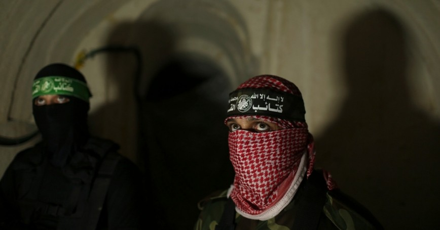 Palestinian fighters from the Izz el-Deen al-Qassam Brigades inside an underground tunnel in Gaza