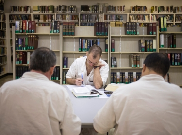 Offenders read and write papers inside the Southwestern Baptist Theological Se