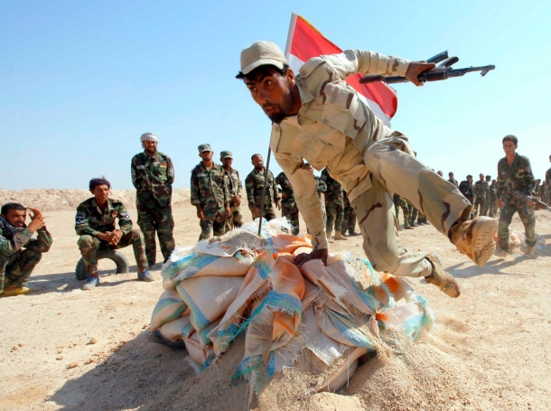 Shi'ite fighters, who have joined the Iraqi army to fight against the Islamic State, take part in field training in the province of Najaf, September 16, 2014