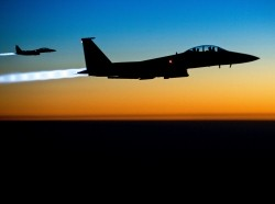 A pair of U.S. Air Force F-15E Strike Eagles fly over northern Iraq after conducting airstrikes against ISIL targets Sept. 23, 2014