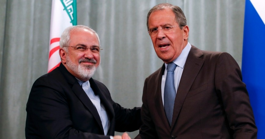 Iranian Foreign Minister Mohammad Javad Zarif and his Russian counterpart Sergei Lavrov shake hands at a news conference in Moscow, August 29, 2014