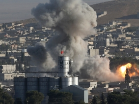 Smoke rises after a U.S.-led airstrike in Kobani, Syria, October 10, 2014