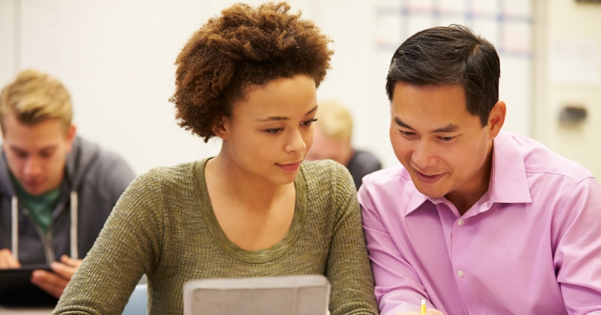 High school student and teacher using digital tablet