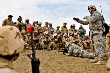 U.S. Army Sgt. instructing Iraqi soldiers on individual movement techniques during a class at the Ghuzlani Warrior Training Center in 2011