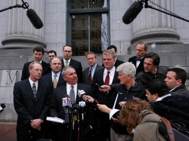 Mark Hulkower and fellow defense attorneys speak to members of the media outside of the U.S. District Court after five Blackwater security guards were charged with killing 14 unarmed civilians and wounding 20 others in a 2007 shooting in Baghdad