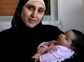 A Syrian refugee and her newborn baby at a clinic in Ramtha, Jordan