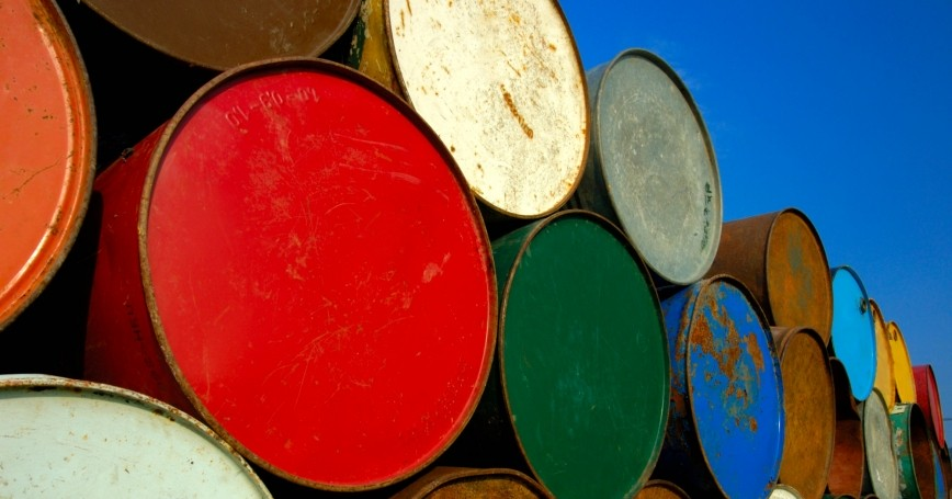 Oil barrels under a clear, blue sky