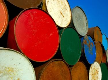 Oil barrels under a clear, blue sky