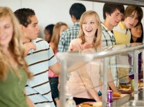 College students in a cafeteria line, photo by CEFutcher/iStock