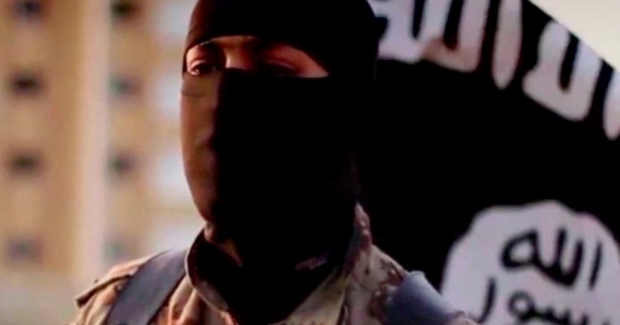 A masked man speaking in what is believed to be a North American accent in a video that Islamic State militants released in September 2014 is pictured in this still frame from video obtained by Reuters, October 7, 2014