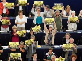 Members of the the Group of the Greens/European Free Alliance hold posters during a voting session on the Anti-Counterfeiting Trade Agreement (ACTA) at the European Parliament in Strasbourg, July 4, 2012