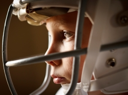 A boy wearing a football helmet