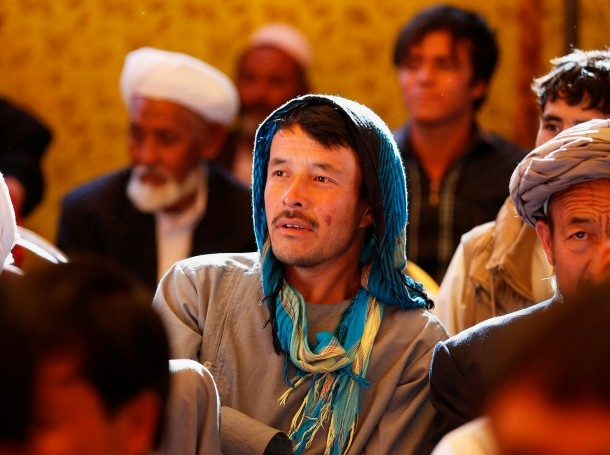 Afghan men attend an election campaign by Afghan presidential candidate Ashraf Ghani Ahmadzai in Kabul, June 8, 2014