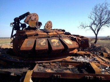 A destroyed T-72 tank, which presumably came from Russia, is seen on a battlefield near separatist-controlled Starobesheve in eastern Ukraine October 2014