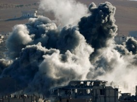An explosion following an air strike in central Kobani, Syria, November 9, 2014