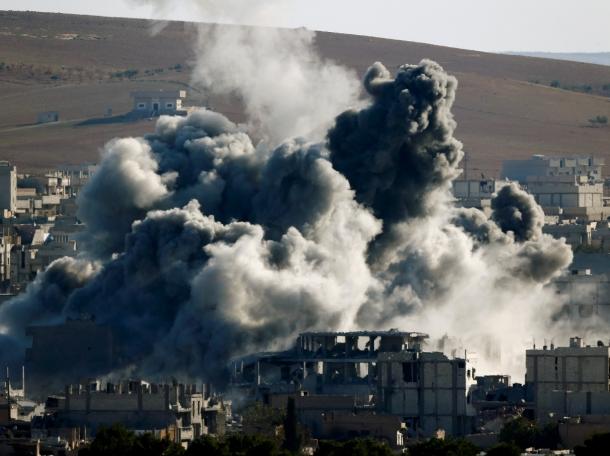 An explosion following an air strike in central Kobani, Syria, November 9, 2014