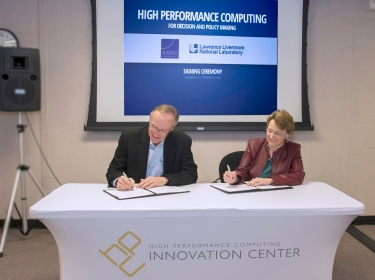 Lawrence Livermore Science and Technology deputy director Greg Suski and RAND's Susan Marquis sign a memorandum of understanding to expand the use of high-performance computing in decision analysis and policymaking, November 21, 2014