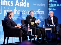 Richard Danzig, Adm. Michael S. Rogers, and Michael E. Leiter at RAND's Politics Aside 2014