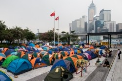 The flags of China and Hong Kong are seen above tents outside Legislative Council Complex at an occupied area in Hong Kong November 11,2014