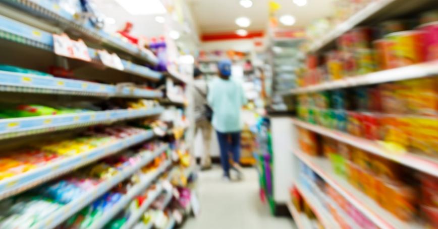 A blurry convenience store aisle