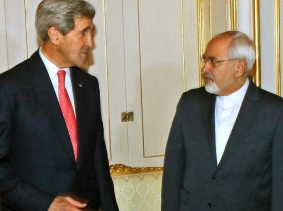 U.S. Secretary of State John Kerry and Iranian Foreign Minister Javad Zarif before a meeting in Vienna November 23, 2014