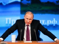 Russian President Vladimir Putin during his annual end-of-year news conference in Moscow, December 18, 2014