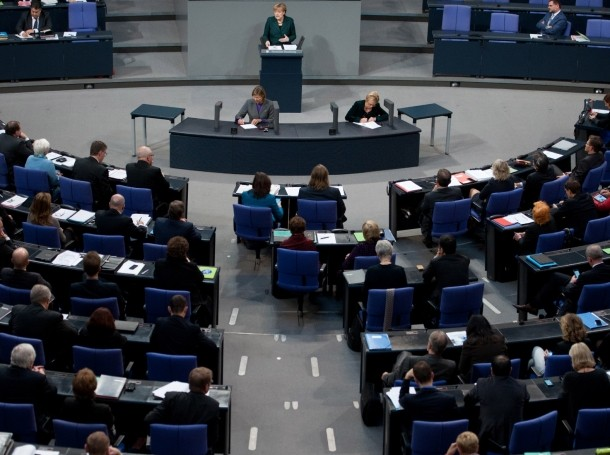 German Chancellor Angela Merkel makes a speech at the lower house of parliament Bundestag in Berlin, Nov. 26, 2014, during which she accuses Russia of violating international law with its interventions in Ukraine and said resolving the conflict would require patience