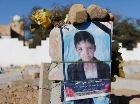 Posters of a boy, killed in Shi'ite-Sunni violence, displayed on his grave in Sanaa, Yemen, November 17, 2014, Photo by Khaled Abdullah/Reuters