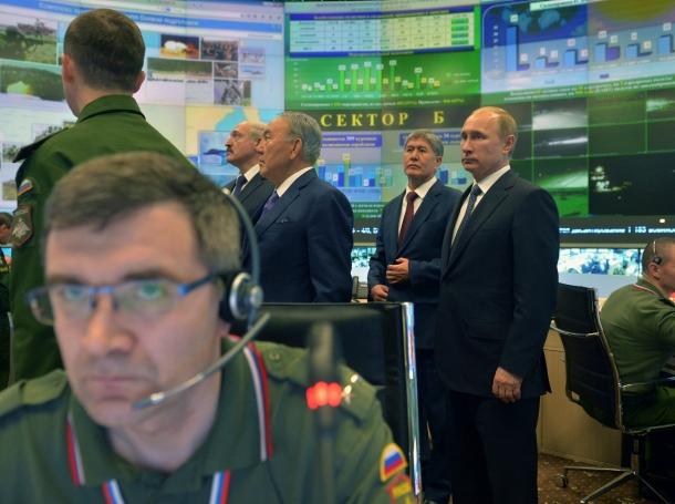 Russia's President Vladimir Putin, Kyrgyzstan's President Almazbek Atambayev, Kazakhstan's President Nursultan Nazarbayev, and Belarus' President Alexander Lukashenko visit the Russian Defense Ministry's control room, Moscow, December 23, 2014