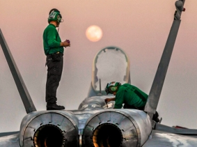 U.S. sailors conduct maintenance on an F/A-18C Hornet on the aircraft carrier USS Carl Vinson Jan. 4, 2015