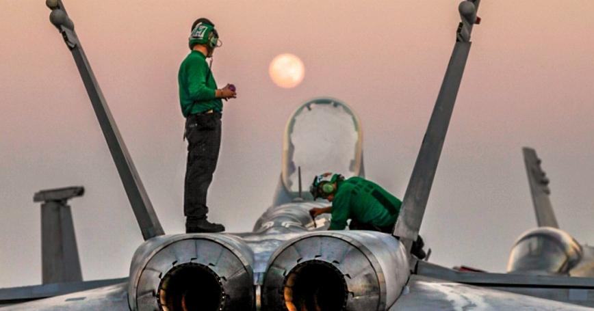 U.S. sailors conduct maintenance on an F/A-18C Hornet on the aircraft carrier USS Carl Vinson Jan. 4, 2015