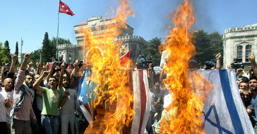 Protesters set fire to U.S. and Israeli flags to protest the Israeli offensive in Lebanon in front of Istanbul University after Friday prayers in Beyazit Mosque in Istanbul, August 4, 2006