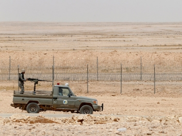 Saudi border guards patrol Saudi Arabia's northern border with Iraq