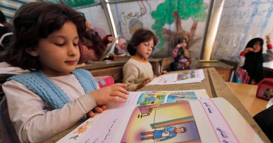 Girls attend a class at the Bab Al-Salam refugee camp in Azaz, near the Syrian-Turkish border, November 19, 2014