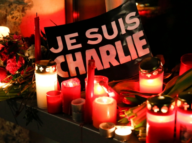 Candles and a placard that reads 'I am Charlie' at the French embassy in Berlin, January 7, 2015, tributes to victims of a shooting at the offices of satirical magazine Charlie Hebdo in Paris