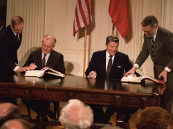 Soviet President Mikhail Gorbachev and U.S. President Ronald Reagan sign the Intermediate-range Nuclear Forces (INF) treaty in the White House on December 8, 1987