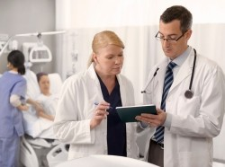 Doctors looking up information about their patient on a tablet
