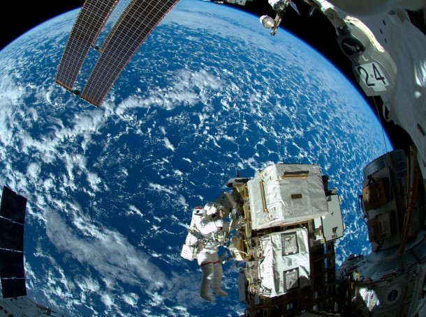 NASA astronaut Reid Wiseman works outside the International Space Station's Quest airlock in October 2014
