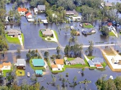 Flood waters from Hurricane Isaac partially submerge homes in Lafitte, Louisiana neighborhoods in August 2012
