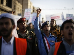 Army and police officers loyal to the Iran-backed Houthi movement shout slogans as they take part in a demonstration to show support in Sanaa, January 23, 2015