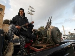 Libyan Police prepare during the start of a security plan to increase security in Tripoli, February 9, 2015